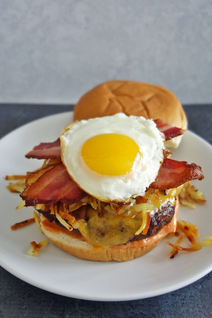 Hangover burger topped with hash browns egg and bacon